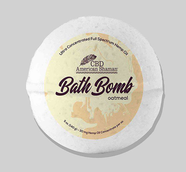 White bath bomb with yellow CBD packaging.