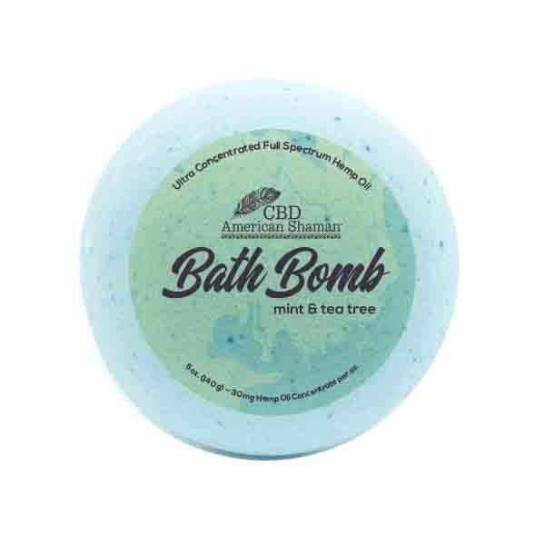 Light blue bath bomb with CBD packaging.