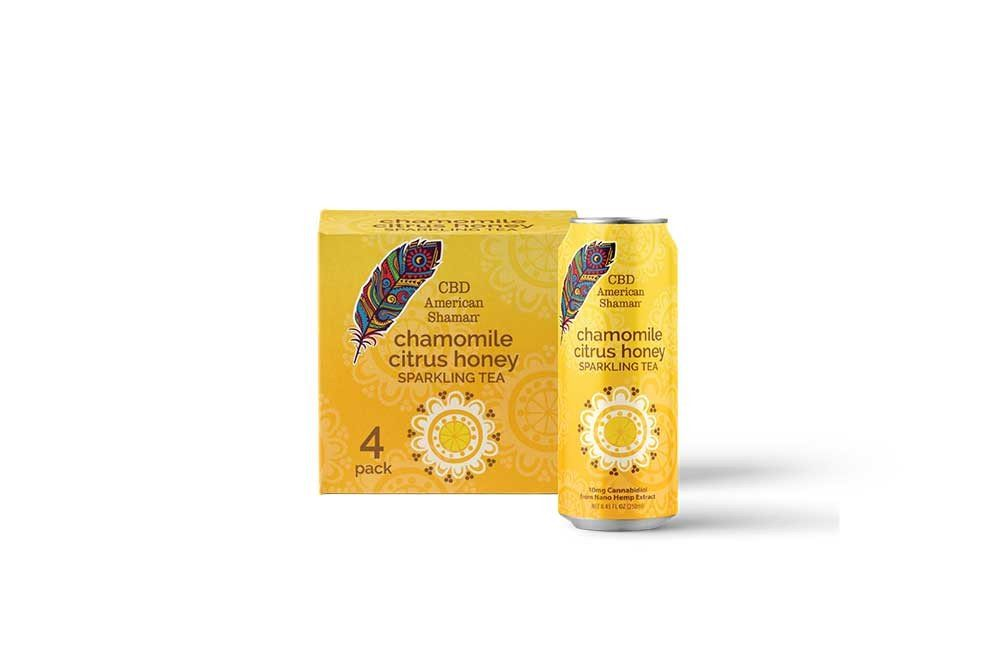 A yellow can of chamomile citrus honey tea, and a box of tea behind it.
