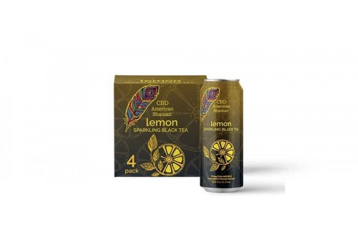 A brown can of lemon tea, and a box of tea behind it.